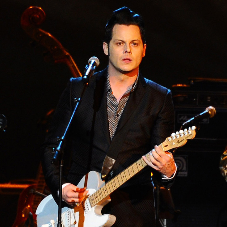 FILE - In this Feb. 6, 2015 file photo, Jack White performs at the 2015 MusiCares Person of the Year show at the Los Angeles Convention Center in Los Angeles. White says he's about to take a long break from performing live but not before holding five mysterious, acoustic-only shows in the five states where he hasn't yet played. The performances will be announced at 8 a.m., local time, on the day of the show. Tickets will cost just $3, be limited to one per person and available only at the venue door starting at noon on the day of the show, according to White's website. (Photo by Vince Bucci/Invision/AP, File)