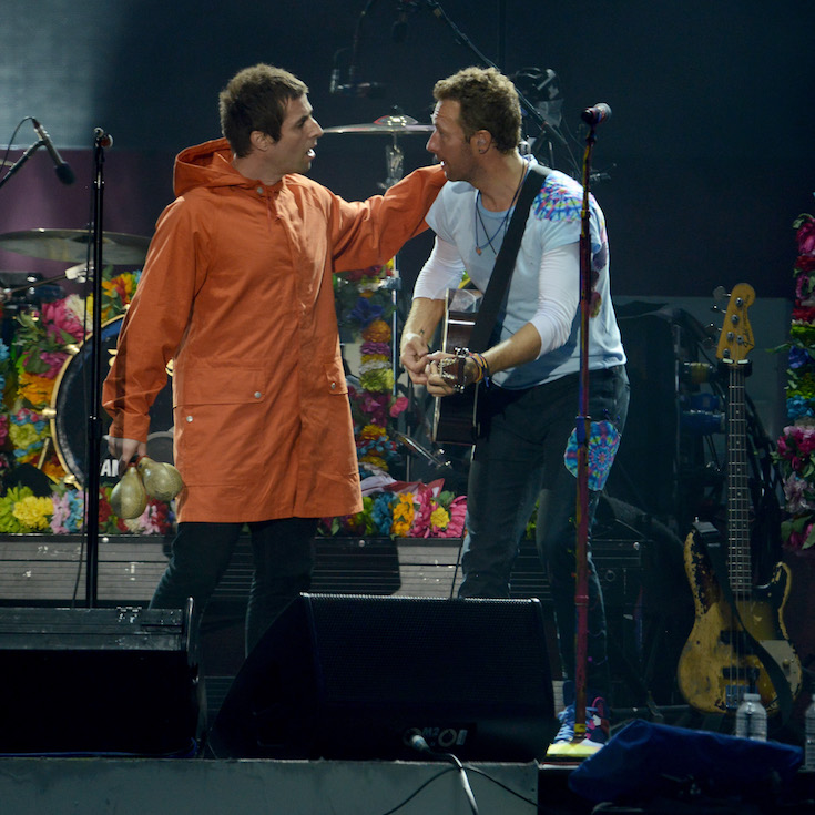 MANCHESTER, ENGLAND - JUNE 04:  NO SALES, free for editorial use. In this handout provided by 'One Love Manchester' benefit concert (L) Liam Gallagher and Chris Martin perform on stage on June 4, 2017 in Manchester, England. Donate at www.redcross.org.uk/love  (Photo by Getty Images/Dave Hogan for One Love Manchester)